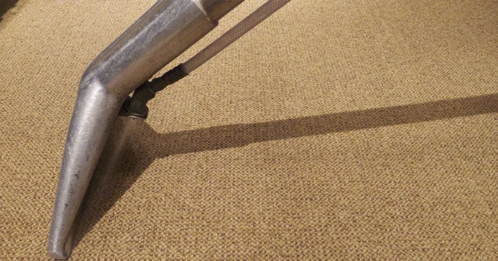 Dirty carpet being cleaned in a Montreal office building