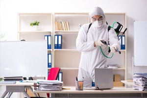 MOM employee disinfecting an office at a business using our cleaning services