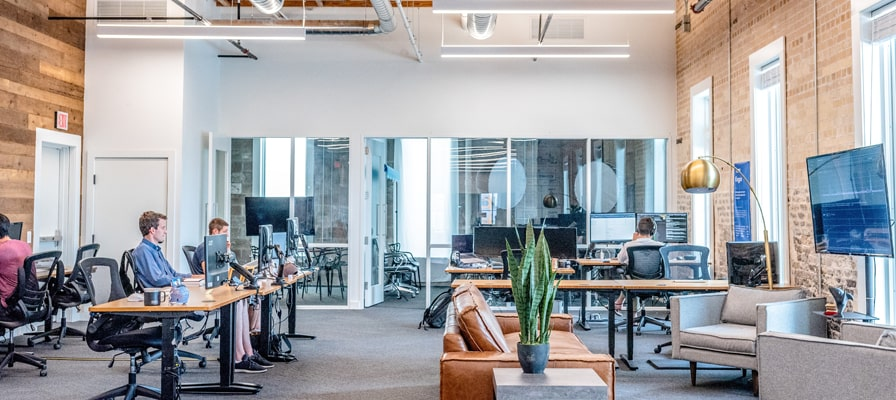 Showing how to work in an office environment in Montreal with employees respecting distancing
