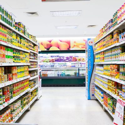 aisle in a grocery maintained by our cleaned services